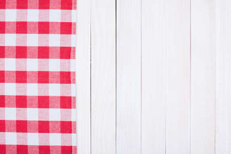 Tablecloth textile texture on wooden table background photo