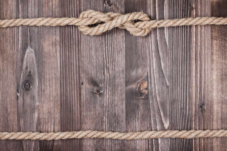Wooden planks with rope background photo