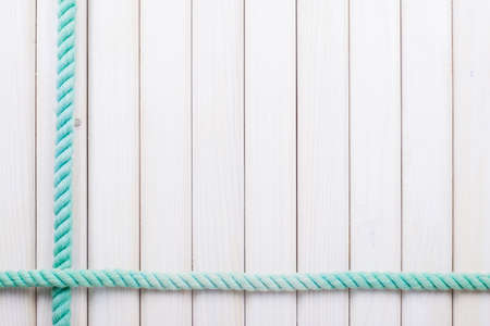 White wooden planks with rope background Standard-Bild