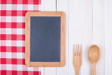 books on a wooden surface: Blackboard, kitchen equipment on white wood background