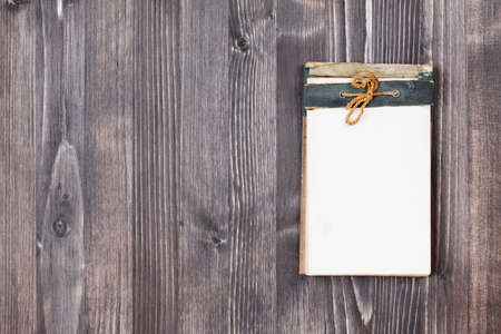 Vintage Old notebook on wooden background photo