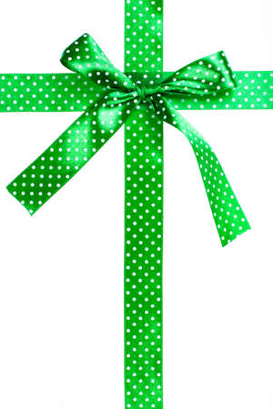Green gift bow and ribbon on white background photo
