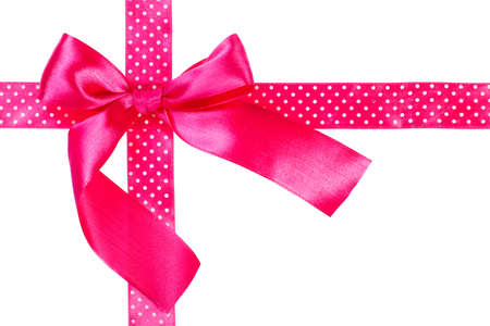 Pink gift bow and ribbon on white background photo