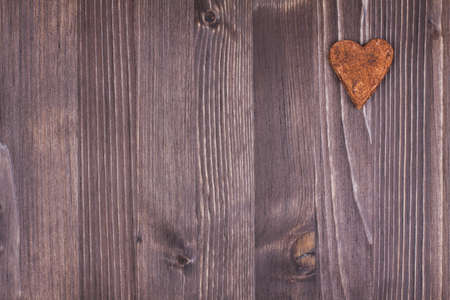 Heart on wood texture background photo