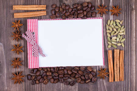 recipe background: Coffee recipe background with cinnamon, star anise, cardamom on wood