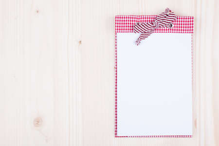 Notebook on white wood background photo