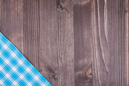 books on a wooden surface: Tablecloth textile texture on wooden table background