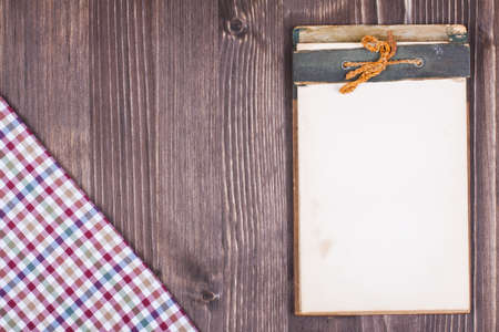 Recipe notebook, tablecloth on wood texture background photo