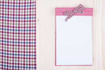Recipe cook notebook, tablecloth on wood texture background photo