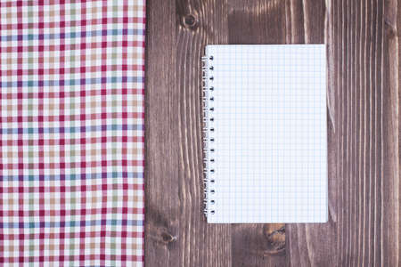 Recipe cook notepad, tablecloth on white wood background photo