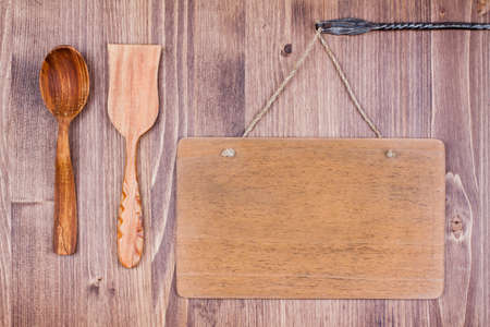 Wooden signboard hanging wall background, spoon, spatula Stock Photo - 19742002