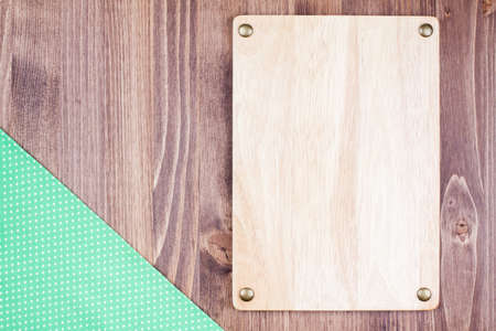 Wooden menu signboard, tablecloth on wooden background photo