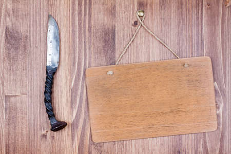 Knife and wooden signboard hanging planks background Stock Photo - 19741995