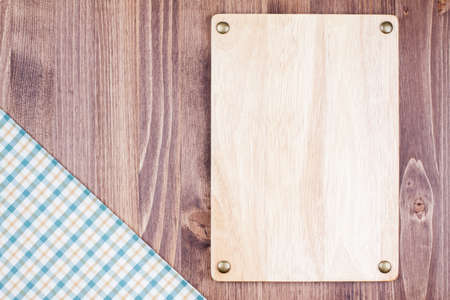 squared: Wooden menu signboard, tablecloth on wooden background Stock Photo