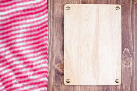 Menu sign board, tablecloth textile on wooden background photo