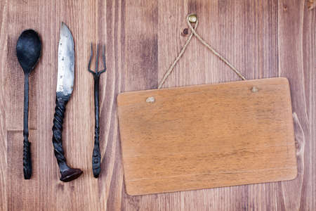 Wooden signboard hanging on wall background with knife, spoon and fork Stock Photo - 19741999