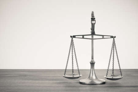 legal law: Scales on a table.