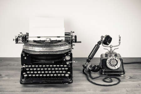 Vintage typewriter and telephone desaturated photo