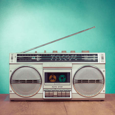 vintage radio: Retro ghetto blaster on mint green background Stock Photo