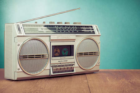 Retro ghetto blaster on table in front mint green background photo