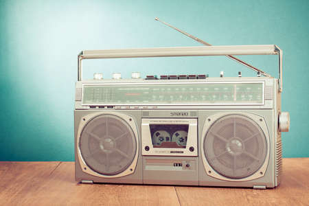 blaster: Retro ghetto blaster on table in front mint green background