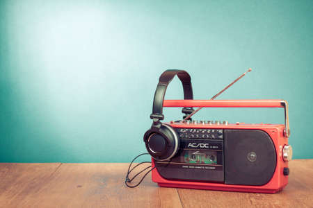 radio frequency: Retro cassette player and phones in front mint green background