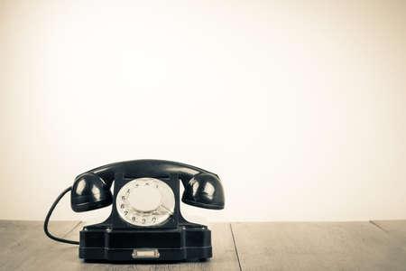 old telephone: Old retro telephone on table sepia photo