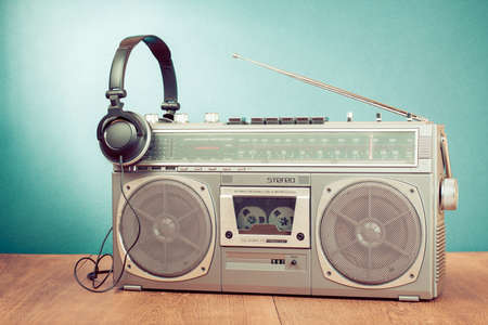 rap: Retro cassette ghetto blaster and headphones in front mint green background