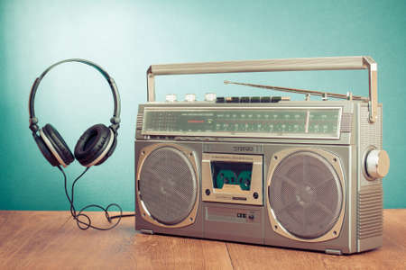 Retro ghetto blaster and headphones conceptual photo photo