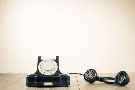 Retro old telephone on table for contact background Standard-Bild