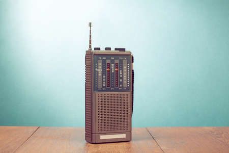 Retro old radio receiver on mint green background 版權商用圖片