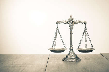 antique weight scale: Law scales on table  Symbol of justice  Sepia photo Stock Photo