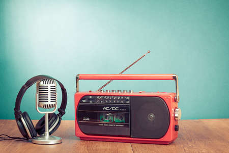 Retro radio and cassette player, headphones, microphone front mint background photo
