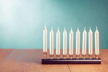Hanukkah menorah with silver candles