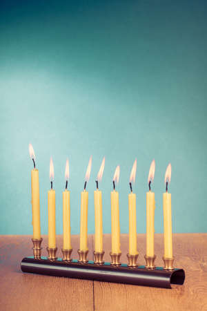 Hanukkah menorah with burning candles on table