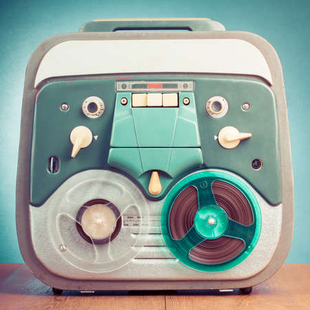 Retro reel to reel tape recorder front mint green background photo