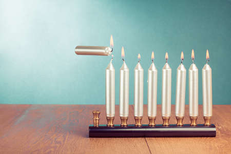 Hanukkah menorah with burning candles conceptual photo