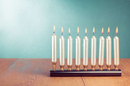 Hanukkah with burning silver candles photo