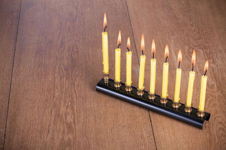 Hanukkah menorah with burning candles on table