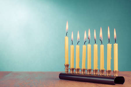Hanukkah with burning candles for background photo