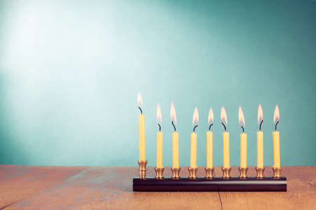 Hanukkah menorah with burning candles on wooden table Banque d'images