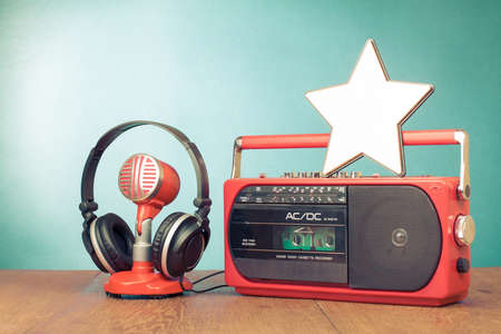 Star blank, retro radio cassette player, microphone, headphones photo