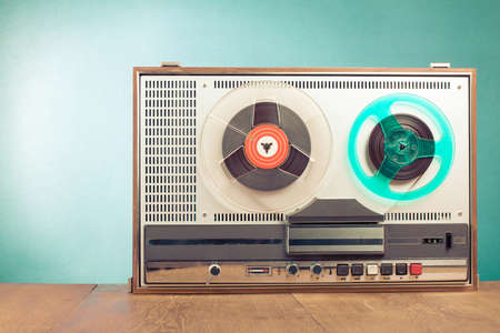 Retro reel tape recorder in front mint green background 版權商用圖片