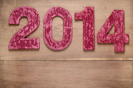 Vintage New Year date on wooden planks background