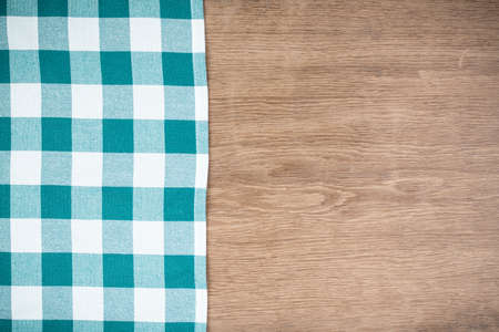 Tablecloth textile on wooden table background