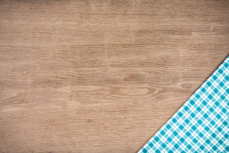 Tablecloth on old wooden table textured background