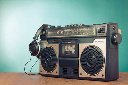 Retro ghetto blaster cassette tape recorder front mint green background