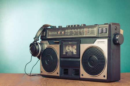 Retro ghetto blaster cassette tape recorder front mint green background