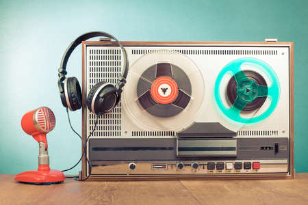 Reel to reel recorder, red microphone, headphones in front mint green background