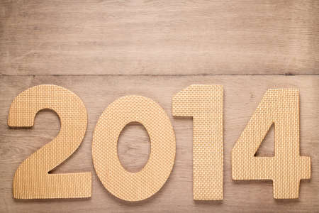 Greeting New Year card with 2014 date on old wood background Banque d'images